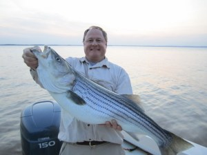 Scott Evander and his 17 pound striper