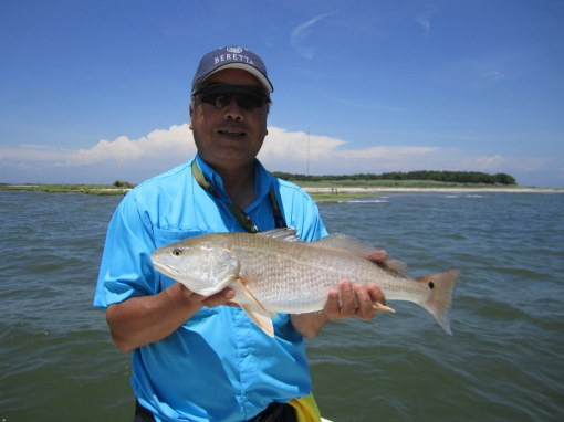 Chen Sun boated this fine redfish on a Berkley Gulp! Swimming Mullet